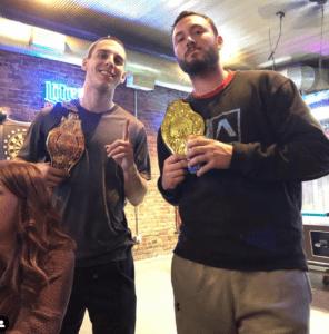 dartboard winners with tropheys